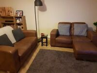 Two genuine good quality leather sofas with mathching pouffe