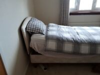 Adjustable single bed only used twice, great condition, buyer uplifts.