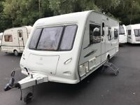 Elddis odyssey 544 4 berth fixed bed touring caravan with full awning