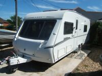 4 berth caravan with rare L-shaped lounge. Abbey Spectrum 545