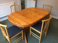 Extendable solid pine dining table and chairs