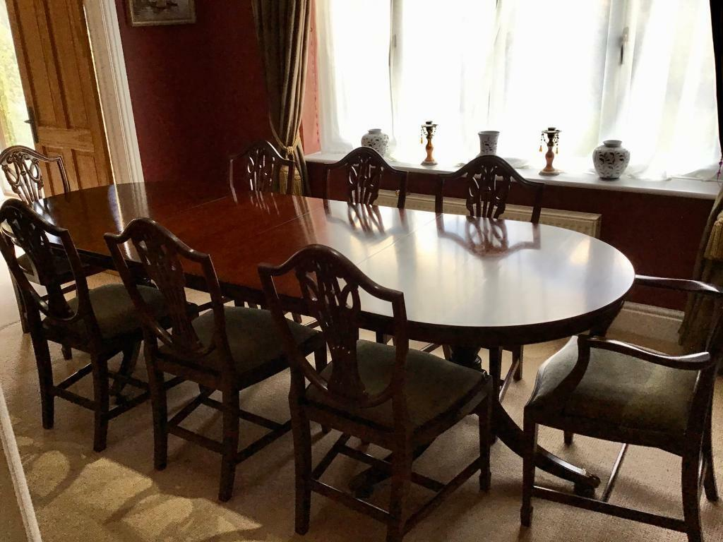 Extendable mahogany dining table with 8 chairs, including ...