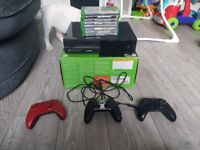 500 gb XBOX ONE WITH 8 GAMES AND 3 PADS