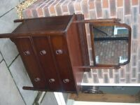 A 1940's mahogany chest of drawers with mirror.
