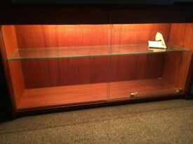 Small wooden display case, with sliding glass doors and glass shelf with fully working lights