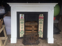 victorian style tiled (some damage) cast iron fireplace and white wooden surround