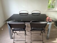 Extending dining room table with chairs