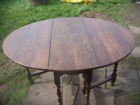 DARK WOOD DROPLEAF / GATELEG DINING TABLE