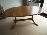 Solid wood extending dining table seats 6/8 or 8/10 extended