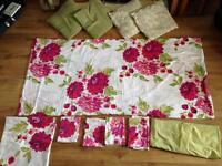 2 double bed sets with matching accessories.