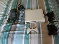 Xbox 360 60G in white with 3 controllers and over 50 games!!