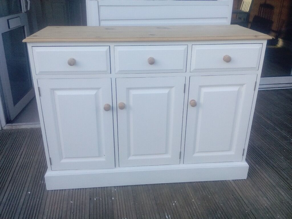 Pine solid shabby chic 3 door sideboard dove tail jointsin Braintree, EssexGumtree - Pine solid shabby chic 3 door sideboard dove tail joints all solid pine with natural pine top and handle and painted in white farrow and ball paint size 34 high 18 deep 48 long inches Braintre