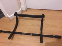 Door frame mounted pull up bar