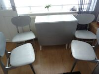 SHABBY CHIC SILVER PAINTED TABLE AND FOUR CHAIRS.