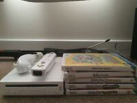 Nintendo wii with 5 games and guitar