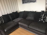 DFS grey and black corner couch with 9 large cushions no rips or tear great condition