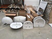 Various sinks and pedestals