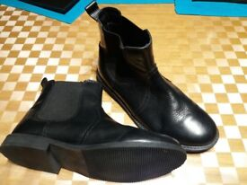 Girls Next black leather boots size 4