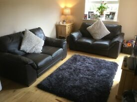 2 Brown DFS leather settee's