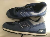 Men's New Balance Trainers.size 11 UK. Navy And Silver .worn twice .Still in original box .