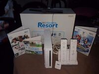 Nintendo Wii comes with box,games. 2x controllers