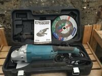 Erbauer 9'' professional grinder, c/w case, tools, guards and spare cutting discs.
