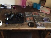 Ps2 console with one controller memory card and 8 ps1 games