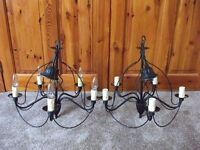 a pair of five bulb hanging lights in black