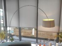 Arched floor lamp with grey lampshade