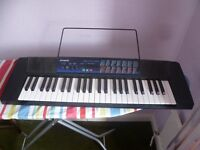 Casio CTK 120 portable keyboard and charger