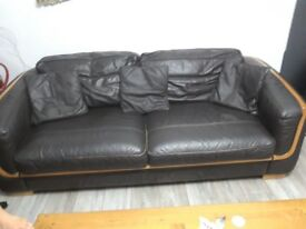 Leather sofa and footstool