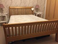 Double wooden bed frame and mattress