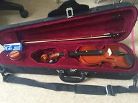 Violin 1/2 sized including case and bow