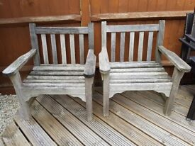 Pair of weathered teak armchairs by Gloster
