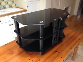 TV STAND: Black glass shelves and anodised black legs suitable for corner location