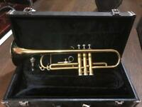Brand new trumpet in box.