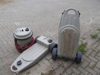 2 waste containers and water barrel and brand new caravan fold up table
