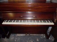 upright piano in a mahogany case