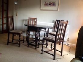 """OAK OVAL DROP LEAF TABLE PLUS 4 CHAIRS WITH BARLEY SUGAR LEGS"
