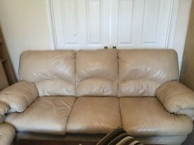 Cream leather three seater sofa and armchair
