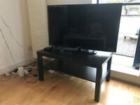 brown/black coffee table / TV stand