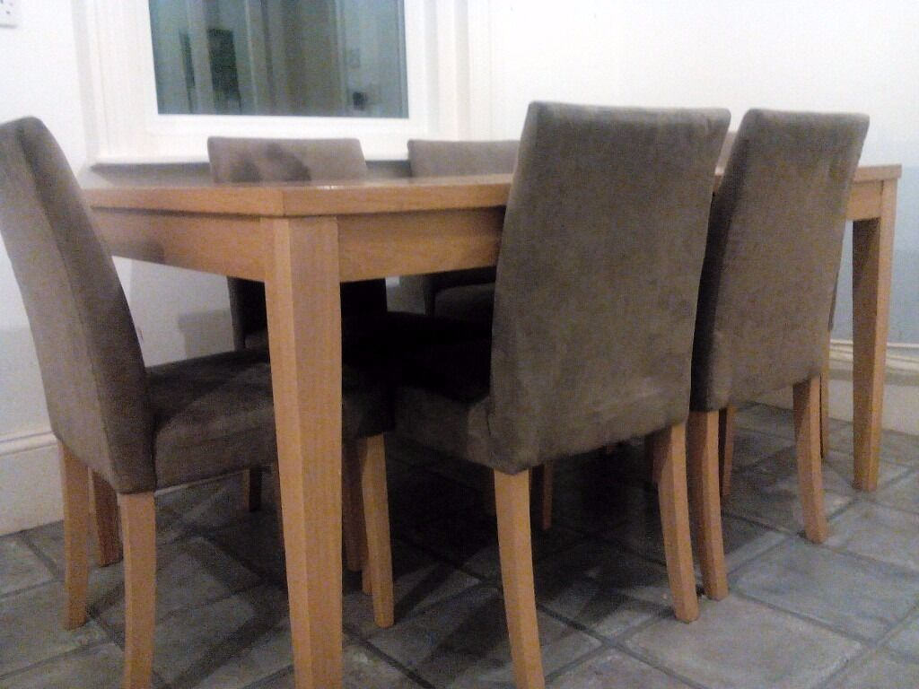 Dining table and 6 chairsin Bournemouth, DorsetGumtree - Dining table with 6 faux suede dining chairs. Dining table 150cm x 90cm. Used condition but from smoke and pet free home. New kitchen forces sale. Table can be dismantled prior to collection if required. Bargain price!! Open to offers. £40.00 the...