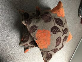 Three brown & orange cushions