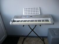 Electric keyboard with stand, headphones and 2 music books