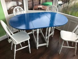 Painted dining table and four chairs