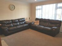 Two DFS brown leather three seater sofas (one sofa bed)