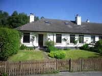 One and a half storey 4 bedroom semi detached cottage in quiet semi- rural location in Gorthleck