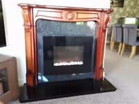 Electric fire and full suuround includind Hearth