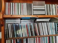 100 CDR cases with assorted albums on CDR discs., most with printed covers.