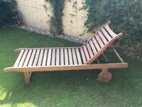 Wooden garden lounger with cushion